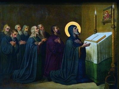Монахи моляться перед Чудотворною іконою Почаївської Богородиці