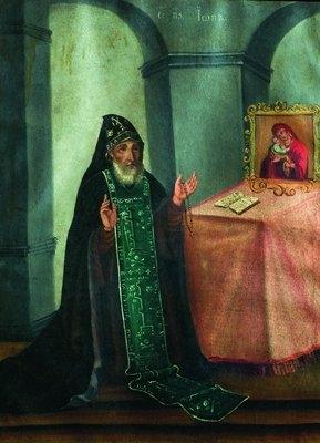 Прп. Іов Почаївський в молитві перед Почаївською іконою Божої Матері
